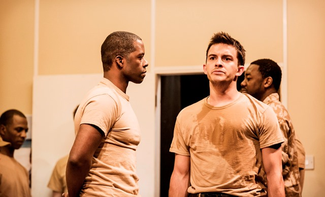 Adrian Lester as Othello, left, and Jonathan Bailey as Cassio - military men under stress