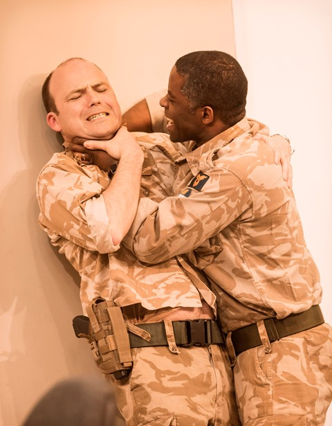 Rory Kinnear as Iago, left, and Adrian Lester as Othello