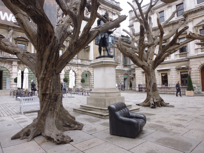 Ai WeiWei's reconstructed trees and marble sofa in the Royal Academy courtyard
