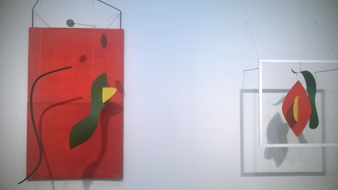 Alexander Calder - installation shot of Red Panel and Snake and Cross, both 1936